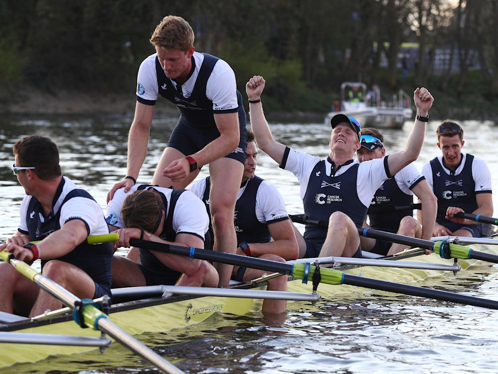Oxford's team celebrate after crossing the line: Getty