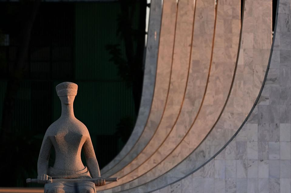 Picture of a statue seen outside the Brazilian Supreme Court in Brasilia, taken during sunset on June 29, 2021.  / AFP / EVARISTO SA