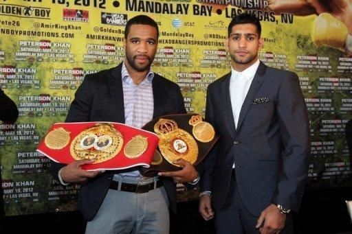 Lamont Peterson (L) and Amir Kahn at a press conference in Washington in March
