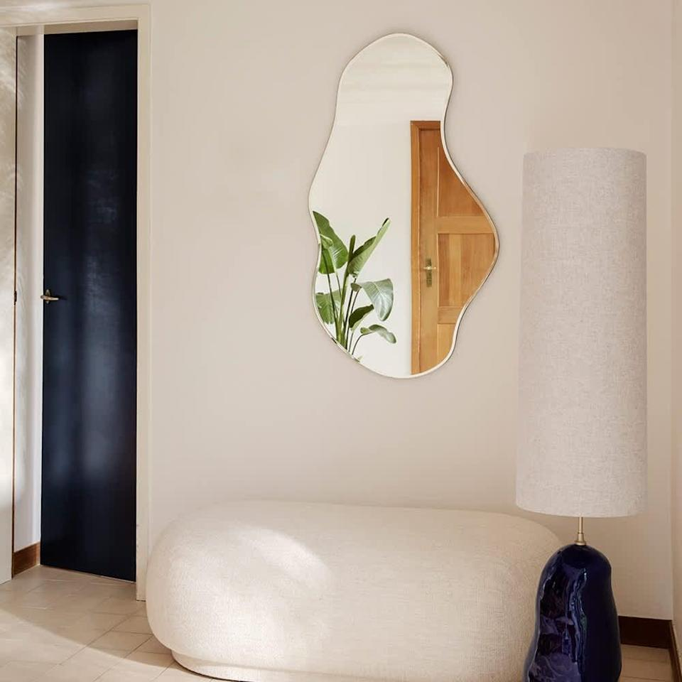 <p>This <span>Ferm Living Pond Mirror</span> ($285) is the finishing touch that will both elevate and add some playfulness to your living room.</p>