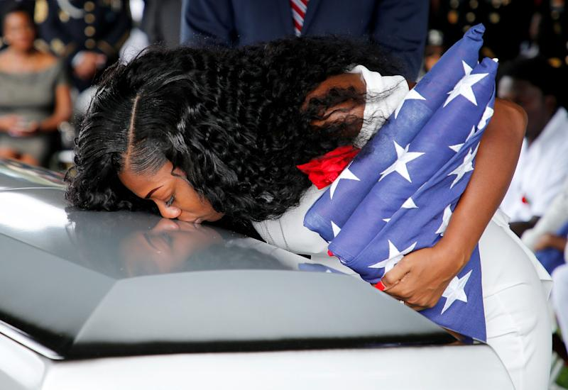 Myeshia Johnson, wife of U.S. Army Sgt. La David Johnson, kisses his coffin at a graveside service in Hollywood, Florida, on Oct. 21. (Joe Skipper / Reuters)