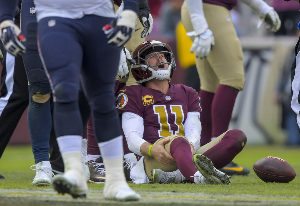 Alex Smith knew immediately after impact that his leg injury was serious after taking a hit against the Texans. (Getty Images)