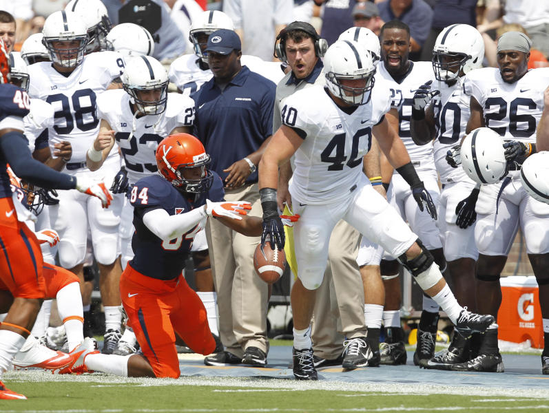 Penn State linebacker Glenn Carson (40) is pushed out of bounds by Virginia wide receiver Canaan Severin (84) after making an interception during the first half of an NCAA college football game Saturday Sept. 8, 2012, in Charlottesville, Va. (AP Photo/Andrew Shurtleff