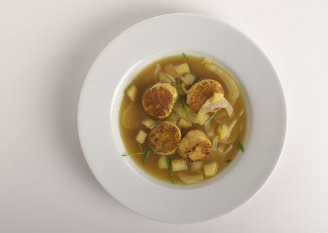 """Dredging the scallops in curry powder before searing them means the spices toast as the scallops cook. <a href=""""https://www.bonappetit.com/recipe/curry-dusted-scallops-with-fennel-apple-broth?mbid=synd_yahoo_rss"""" rel=""""nofollow noopener"""" target=""""_blank"""" data-ylk=""""slk:See recipe."""" class=""""link rapid-noclick-resp"""">See recipe.</a>"""