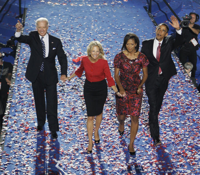 FILE - In this Aug. 28, 2008 file photo, Democratic vice presidential nominee then-Sen. Joe Biden, D-Del., and wife, Jill,, left, and Democratic presidential nominee, then-Sen. Barack Obama, D-Ill., and his wife, Michelle, wave to the crowd after Obama's acceptance speech at the Democratic National Convention in Denver. Long gone are the passionate debates. Long gone is the suspense about who will emerge as the party's presidential nominee. Political conventions now are carefully scripted pep rallies aimed at a national TV audience. Not since the 1970s, in fact, has the nation had a major-party national convention begin with the nominee in doubt. Americans already know how the story will end at this year's Republican and Democratic national gatherings. So have modern-day conventions become irrelevant? (AP Photo/Chris Carlson, File)