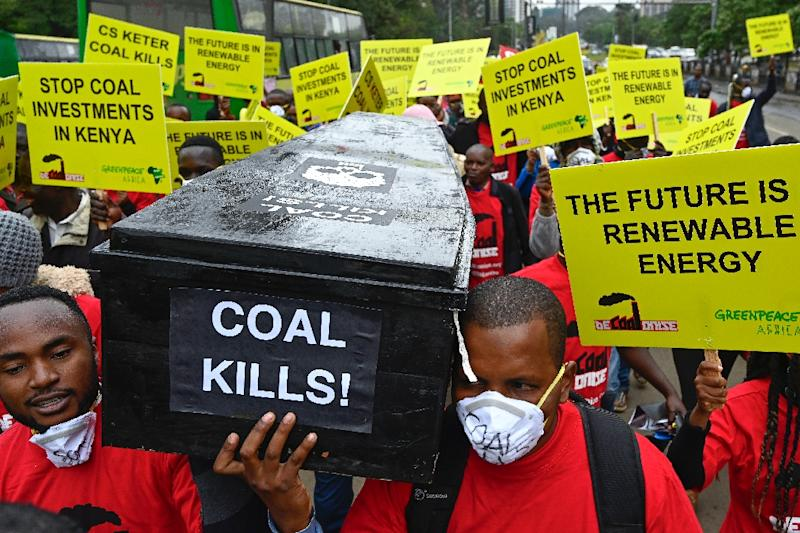 Protesters march in downtown Nairobi to demonstrate against a coal-fired power station planned for Kenya's heritage-listed Lamu archipelago (AFP Photo/SIMON MAINA)