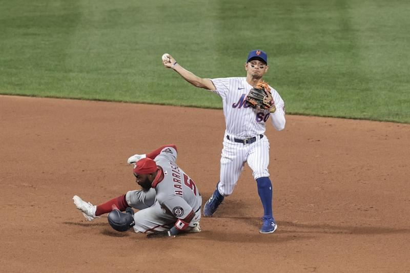 Andres Gimenez makes throw from second base