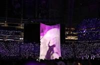 <p>Justin Timberlake performs during the halftime show as a projection of the late singer Prince is shown. REUTERS/Chris Wattie </p>