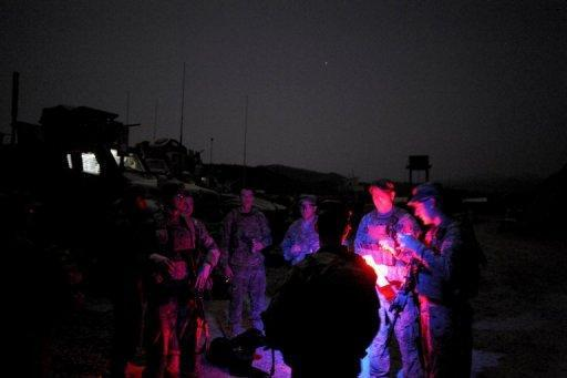 Soldiers of the US Army get ready for a patrol operation at the Buwri Tana base, in Buwri Tana District in Khost Province in August 2012. President Barack Obama is weighing plans to keep roughly 10,000 US troops in Afghanistan after the NATO-led force hands over security to the Afghan government, a senior US official said Monday