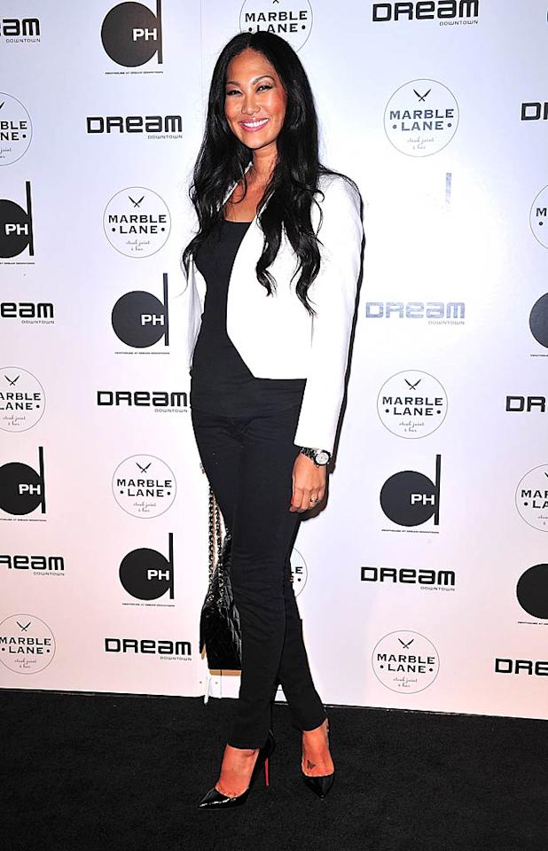 """Kimora Lee Simmons was all smiles in her skinny black pants and white blazer. """"I headed over to a party for the grand opening of my friend Vikram Chatwal's party for the Dream Hotel,"""" Kimora wrote on her website later. """"What a beautiful space and an energetic crowd."""" James Devaney/<a href=""""http://www.wireimage.com"""" target=""""new"""">WireImage.com</a> - June 15, 2011"""