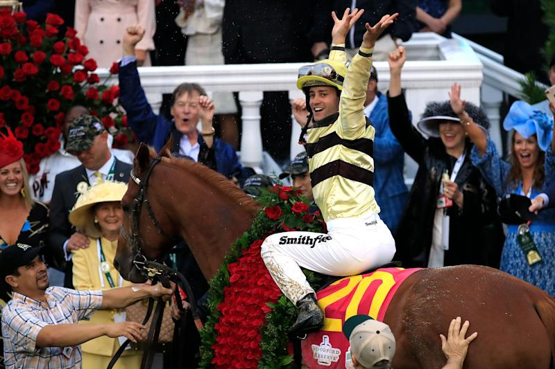 Jockey Flavien Prat celebrates atop Country House after winning the 145th running of the Kentucky Derby at Churchill Downs. (Getty Images)