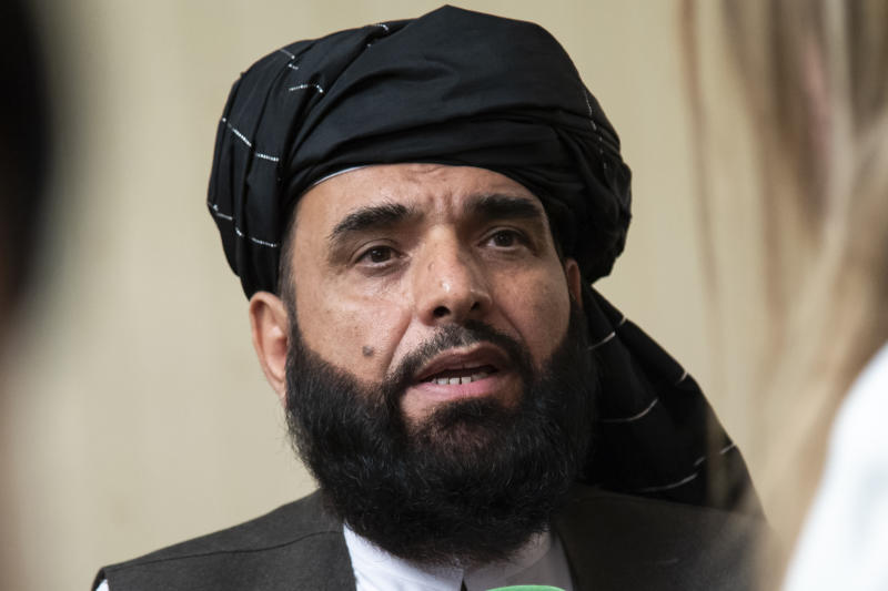 FILE - In this May 28, 2019, file photo, Suhail Shaheen, spokesman for the Taliban's political office in Doha, speaks to the media in Moscow, Russia. After months of deliberation Afghan President Ashraf Ghani announced his 21-member team to negotiate peace with the Taliban, only to have his political opponent reject it Friday, March 27, 2020, as not inclusive enough. Shaheen said the Taliban would send four members to Bagram, north of Kabul, to oversee the release of their prisoners, also part of the deal signed with the United States. (AP Photo/Alexander Zemlianichenko, File)