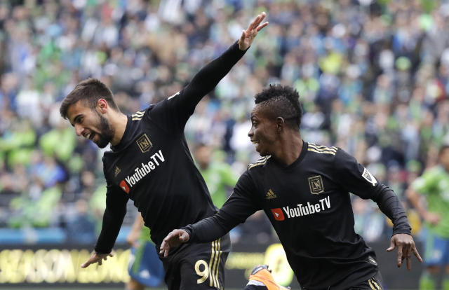 Los Angeles FC forward Diego Rossi, left, celebrates with Latif Blessing, right, after scoring a goal against the Seattle Sounders during the first half of an MLS soccer match, Sunday, March 4, 2018, in Seattle. (AP Photo/Ted S. Warren)