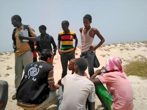 IOM staff assistSomaliand Ethiopian migrants who were forced into the sea by smugglers. (UN International Organization for Migration)