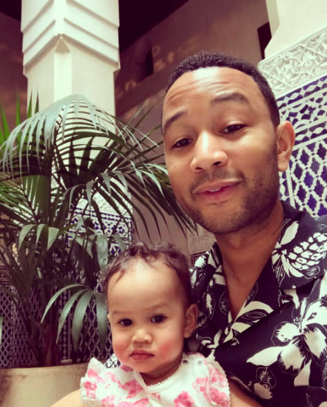 """<p>Seeing Chrissy and John in their color-coordinated outfits is cute andeverything (don't try to tell us that wasn't planned!), but this father-daughter snap tops it. The ivory tickler sported a tropical print shirt as part of his vacation attire and struck a pose along with his little lady, who looked, dare we say, unimpressed, but in the cutest way possible. """"Vacation vibes,"""" he wrote.(Photo: <a rel=""""nofollow"""" href=""""https://www.instagram.com/p/BRyQCdGjmZy/?taken-by=johnlegend&hl=en"""">Instagram</a>) </p>"""
