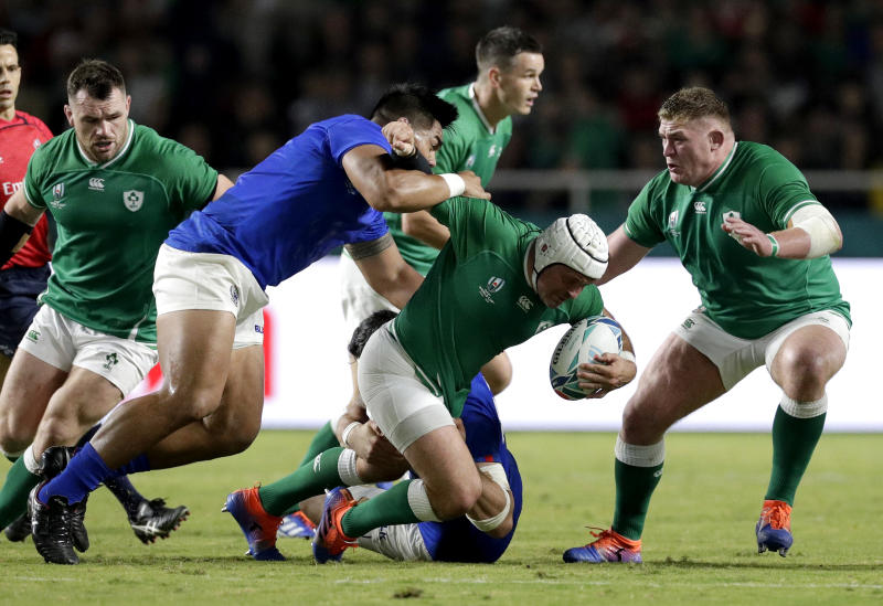 Ireland's Rory Best is tackled by the Samoan defence during the Rugby World Cup Pool A game at Fukuoka Hakatanomori Stadium between Ireland and Samoa, in Fukuoka, Japan, Saturday, Oct. 12, 2019. (AP Photo/Aaron Favila)