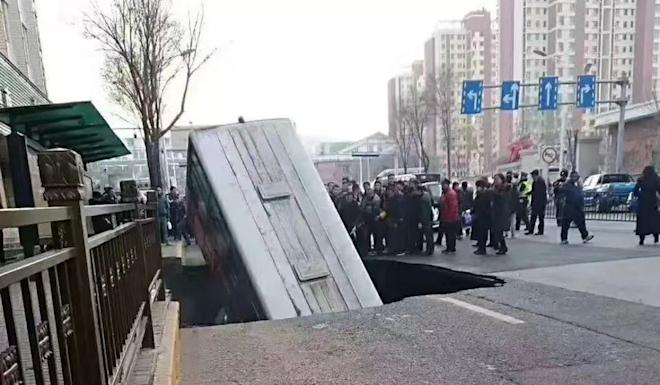The sinkhole opened up on a busy road in Xining, Qinghai province. Photo: Weibo