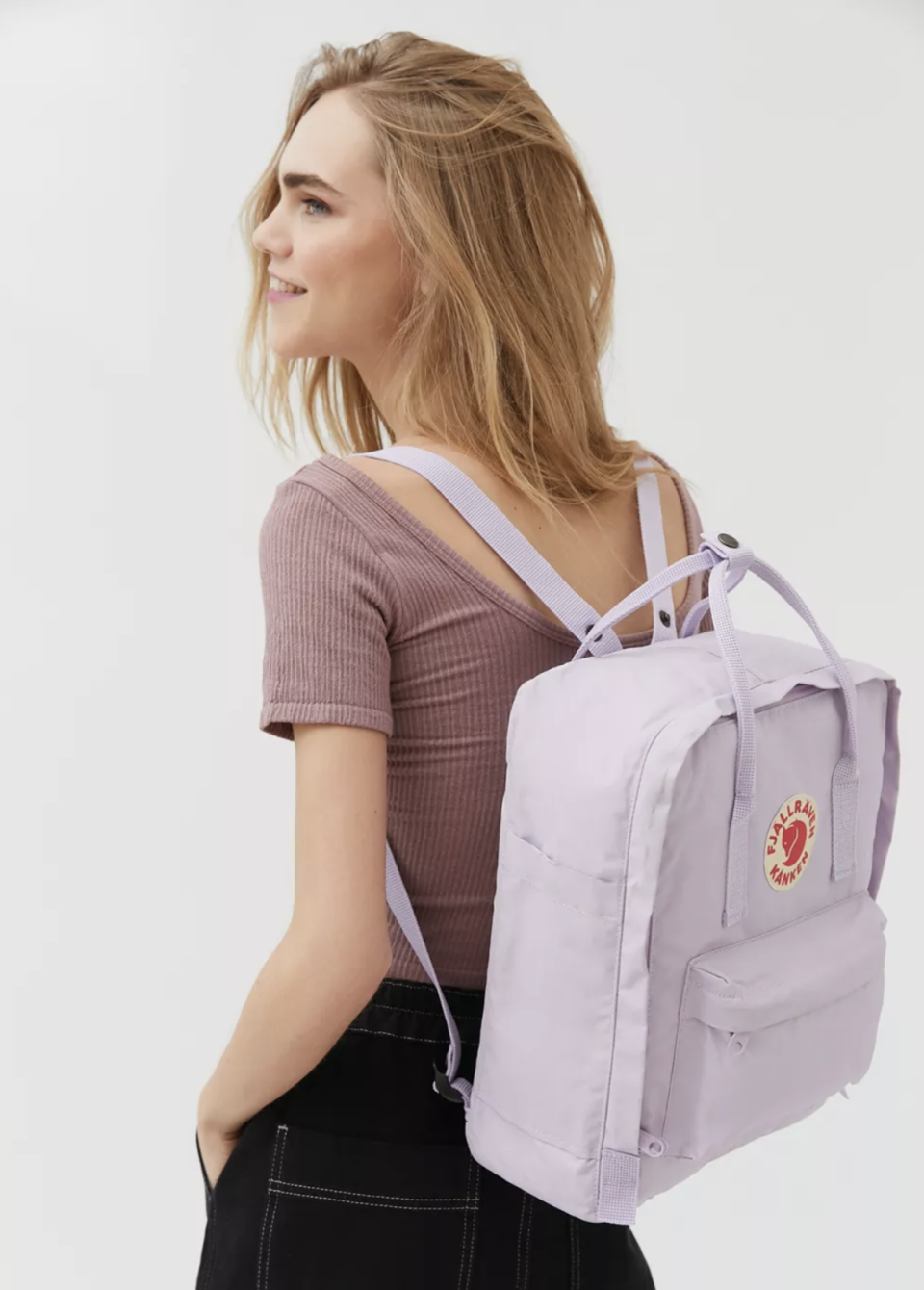 The best backpacks for middle & high school: Fjallraven Classic Kånken Backpack in Lavender (Photo via Urban Outfitters)