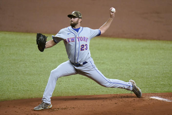 New York Mets' David Peterson pitches to the Tampa Bay Rays during the first inning of a baseball game Friday, May 14, 2021, in St. Petersburg, Fla. (AP Photo/Chris O'Meara)