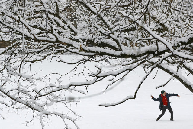 <p>A man throws a snowball in a park Wednesday, March 21, 2018, in Baltimore. A spring nor'easter targeted the Northeast on Wednesday with strong winds and a foot or more of snow expected in some parts of the region. (Photo: Patrick Semansky/AP) </p>