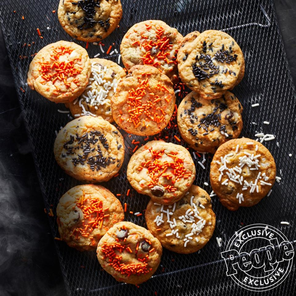 """Customize <a href=""""https://www.cookiedonyc.com/"""">DŌ</a> owner Kristen Tomlan's treats with any combination of Halloween-colored sprinkles you have — the moist yet crunchy texture will be all the same. """"It's perfect for when you can't decide between a cupcake and a cookie!"""" says the author of the new <em><a href=""""https://www.amazon.com/Hello-Cookie-Dough-Doughlicious-Confections-ebook/dp/B07NCXP7T2"""">Hello, Cookie Dough</a></em>cookbook.  Get the recipe <a href=""""https://people.com/food/kristen-tomlan-sprinkle-cake-batter-cookies/"""">HERE</a>."""