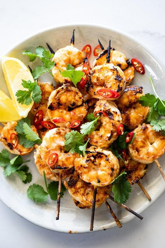 """<p> The <a href=""""http://simply-delicious-food.com/spicy-garlic-shrimp-skewers/"""" class=""""link rapid-noclick-resp"""" rel=""""nofollow noopener"""" target=""""_blank"""" data-ylk=""""slk:shrimp garlic skewers"""">shrimp garlic skewers</a> are marinated in chili, garlic, and an array of spices for a flavorful, light, and delicious meal. </p>"""