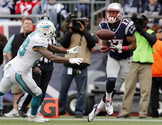 New England Patriots wide receiver Aaron Dobson (17) catch a touchdown pass in front of Miami Dolphins cornerback Nolan Carroll (28) in the second half of an NFL football game Sunday, Oct. 27, 2013, in Foxborough, Mass. (AP Photo/Michael Dwyer)
