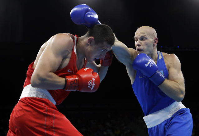 FILE - In this Monday, Aug. 15, 2016 file photo, Kazakhstan's Vassiliy Levit, right, fights Russia's Evgeny Tishchenko during a men's heavyweight 91-kg final boxing match at the 2016 Summer Olympics in Rio de Janeiro, Brazil. The International Boxing Association has as few as six weeks left to save the sports place at the 2020 Olympics. Now its new interim president has arrived in the IOCs home city Lausanne for the final rounds of lobbying. Mohamed Moustahsane is a long-time ringside doctor from Morocco, who praised his predecessor whose alleged links to organized crime helped provoke the crisis in Olympic boxing. (AP Photo/Frank Franklin II, FIle)