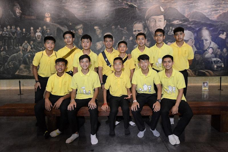 "Members of the ""Wild Boars"" football team pose at the Tham Luang cave centre as they mark the first anniversary of their rescue (AFP Photo/Jittrapon KAICOME)"