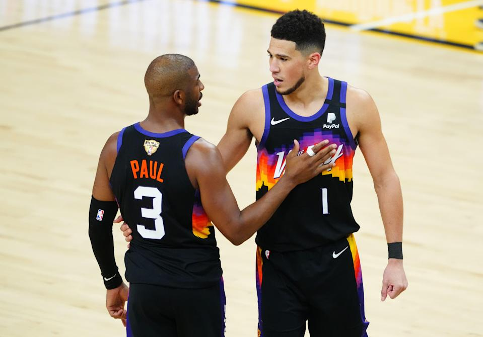 Devin Booker (1) is facing questions about his scoring while Chris Paul is being questioned about his playoff history.
