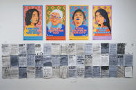 """Posters created by the City of New York to combat Asian hate are on display during the press preview of """"Responses: Asian American Voices Resisting the Tides of Racism"""" at the Museum of Chinese in America, Wednesday, July 14, 2021, in New York. (AP Photo/Mary Altaffer)"""