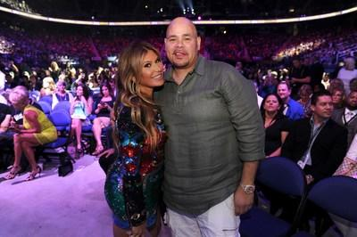 Loren Ridinger and recording artist and Grammy nominee, Fat Joe take a moment for a photo opp as they continue to celebrate the success of the company's Shopping Annuity business model. (PRNewsfoto/Market America | SHOP.COM)