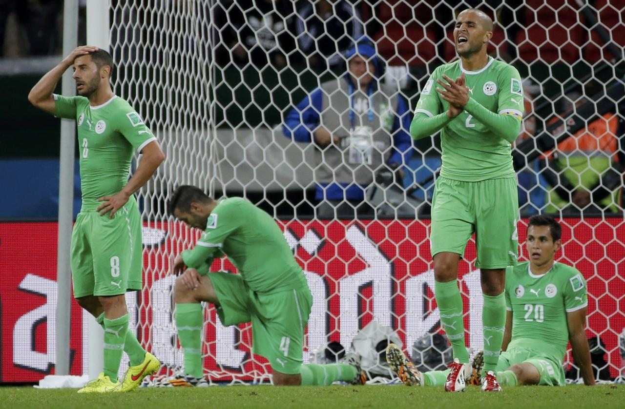 Algeria's players react after conceding a second goal against Germany in extra time during their 2014 World Cup round of 16 game at the Beira Rio stadium in Porto Alegre June 30, 2014. REUTERS/Edgard Garrido (BRAZIL - Tags: SOCCER SPORT WORLD CUP)