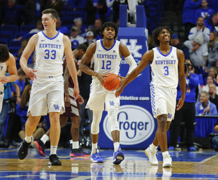 Kentucky Wildcats guard Tyrese Maxey (3) forward Keion Brooks (12) and forward Ben Jordan (33) celebrate at the end of the game against the Eastern Kentucky Colonels at Rupp Arena. Mandatory Credit: Mark Zerof-USA TODAY Sports