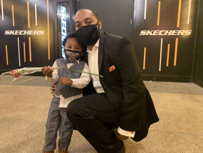 """<div class=""""inline-image__caption""""><p>Action Jackson, holding a rose for his mom Lindsey who performs in 'The Lion King,' and dad Aaron.</p></div> <div class=""""inline-image__credit"""">Tim Teeman</div>"""