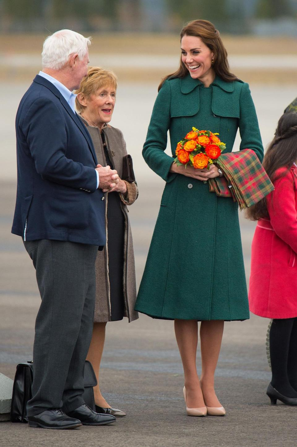 <p>The Duchess flew to a much colder part of Canada in a dark green trench coat from high street label, Hobbs, paired with her favourite LK Bennett bag and heels. </p><p><i>[Photo: PA]</i></p>