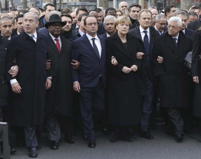 FILE - In this Jan. 11, 2015 file photo, from left : Israel's Prime Minister Benjamin Netanyahu, Mali's President Ibrahim Boubacar Keita, France's President Francois Hollande, Germany's Chancellor Angela Merkel, EU President Donald Tusk, and Palestinian President Mahmoud Abbas march during a rally in Paris. The January 2015 attacks against Charlie Hebdo and, two days later, a kosher supermarket, touched off a wave of killings claimed by the Islamic State group across Europe. Seventeen people died along with the three attackers. Thirteen men and a woman accused of providing the attackers with weapons and logistics go on trial on terrorism charges Wednesday Sept. 2, 2020. (Philippe Wojazer, Pool via AP, File)