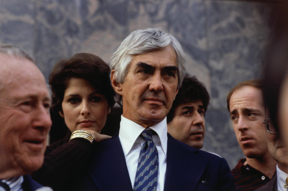 (Original Caption) Los Angeles, CA.: Auto tycoon John DeLorean who was arrested on cocaine charges in late October, arrives with his wife, Christina Ferrare at the courthouse here 12/15, where his lawyers will attempt to get his 10-million dollar bail reduced. He is accused of conspiring to finance a 24-million dollar cocaine deal to save his bankrupt sports car company.
