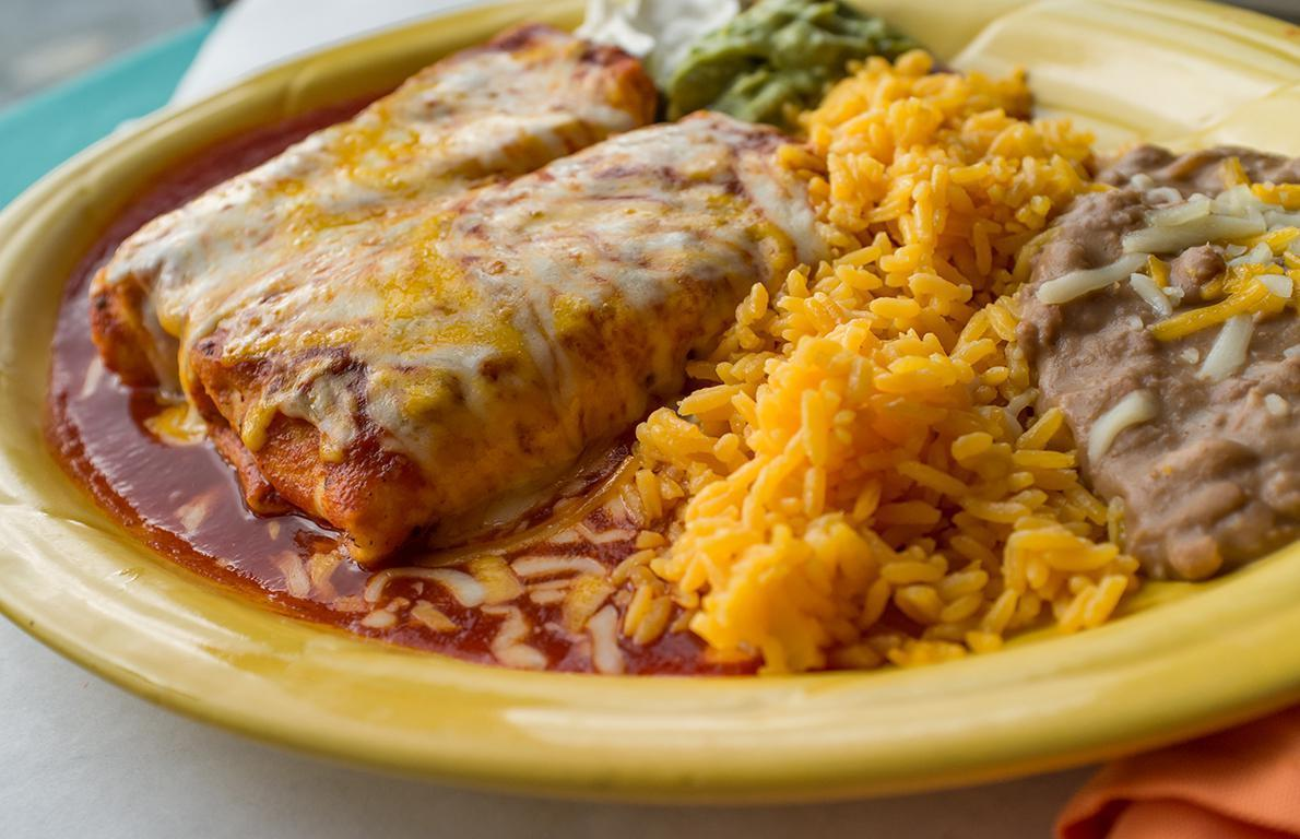 """<p>The chimichanga is one of those <a href=""""https://www.thedailymeal.com/eat/dishes-didnt-know-american?referrer=yahoo&category=beauty_food&include_utm=1&utm_medium=referral&utm_source=yahoo&utm_campaign=feed"""">dishes you may not realize are American in origin</a>. This Southwestern staple has a bit of a contested history, but as the story goes, the chimichanga was invented at<a href=""""https://www.thedailymeal.com/el-charro-cafe?referrer=yahoo&category=beauty_food&include_utm=1&utm_medium=referral&utm_source=yahoo&utm_campaign=feed""""> El Charro</a> in Tucson,<a href=""""https://www.thedailymeal.com/best-food-drink-arizona-2018-slideshow?referrer=yahoo&category=beauty_food&include_utm=1&utm_medium=referral&utm_source=yahoo&utm_campaign=feed""""> Arizona</a>, when the restaurant's founder Monica Flin accidentally dropped a burrito in a deep fryer. It was a beautiful accident, though, resulting in this crispy, iconic dish.</p>"""