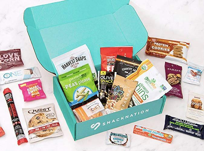 """<h2>18. SnackNation</h2> <p><strong>Cost:</strong> $40/month ($24 for your first box)</p> <p><strong>What you get: </strong>25 snacks</p> <p><strong>Why we love it: </strong>Up your snack game with delicious and better-for-you options delivered straight to your kitchen. Packed with chips, nuts, nutrition bars, jerky and more from innovative brands you can't find at the average grocery store, <a href=""""http://www.snacknation.com"""" rel=""""nofollow noopener"""" target=""""_blank"""" data-ylk=""""slk:SnackNation"""" class=""""link rapid-noclick-resp"""">SnackNation</a> has plans that range from 8 to 150 snacks a month, curated for everyone from the busy college student to an office full of employees looking for a 3 p.m. snack.</p> <p><a class=""""link rapid-noclick-resp"""" href=""""https://www.amazon.com/gp/product/B07DVM8MM5/ref=as_li_ss_tl?ie=UTF8&linkCode=sl1&tag=pur0e4-20&linkId=3a2f053e0c18b598720a74e246f56f16&language=en_US"""" rel=""""nofollow noopener"""" target=""""_blank"""" data-ylk=""""slk:Sign up for SnackNation"""">Sign up for <em>SnackNation</em></a></p>"""