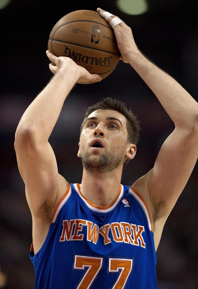 New York Knicks' Andrea Bargnani shoots a free throw against the Toronto Raptors during first-half NBA basketball preseason game action in Toronto, Friday, Oct. 11, 2013. (AP Photo/The Canadian Press, Frank Gunn)