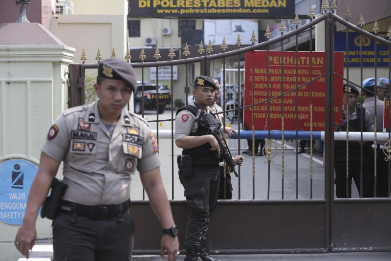 Picture of police, armed, outside the police headquarters in Medan, where a suicide bomber killed himself.