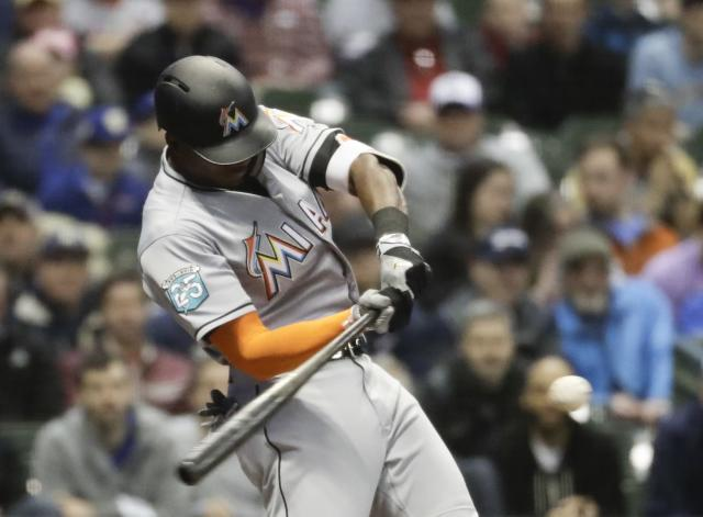 Miami Marlins' Lewis Brinson hits a home run during the third inning of a baseball game against the Milwaukee Brewers Thursday, April 19, 2018, in Milwaukee. (AP Photo/Morry Gash)