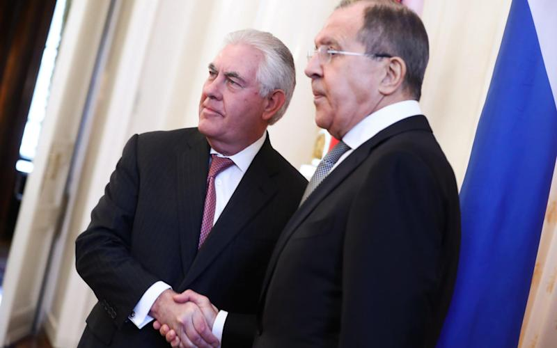 US Secretary of State Rex Tillerson (L) and Russia's Foreign Minister Sergei Lavrov shake hands in Moscow - Credit: TASS / Barcroft Images