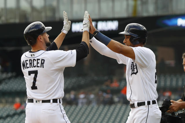 Detroit Tigers' Jordy Mercer (7) celebrates his two-run home run with Victor Reyes in the first inning of a baseball game against the Baltimore Orioles in Detroit, Monday, Sept. 16, 2019. (AP Photo/Paul Sancya)
