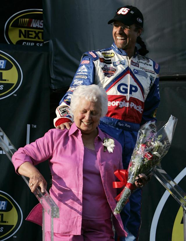 FILE - In this May 7, 2005, file photo, Kyle Petty, top, smiles as he is introduced to fans along with his mother, Lynda Petty, before a NACAR race at the Darlington Speedway in Darlington, S.C. The drivers honored their mothers at Saturday night's race and continued their tradition of not racing on Mother's Day. Lynda Petty, the wife of NASCAR Hall of Famer Richard Petty, has died after battling cancer. She was 72. Jeff Dennison of Petty Motorsports says in a statement that Petty was surrounded by her family when she died at her home in Level Cross, N.C., on Tuesday, March 25, 2014. Dennison says Petty had been fighting cancer for the past several years. (AP Photo/Patrick Collard, File)