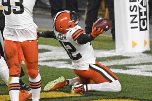 Cleveland Browns strong safety Karl Joseph (42) celebrates after recovering a fumbled in the end zone for a touchdown during the first half of an NFL wild-card playoff football game against the Pittsburgh Steelers in Pittsburgh, Sunday, Jan. 10, 2021.(AP Photo/Don Wright)