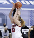 Virginia Tech's Elizabeth Kitley, rear, blocks the shot by North Carolina State's Elissa Cunane (33) during the first half of an NCAA college basketball game in the Atlantic Coast Conference women's tournament in Greensboro, N.C., Friday, March 5, 2021. (Ethan Hyman/The News & Observer via AP)