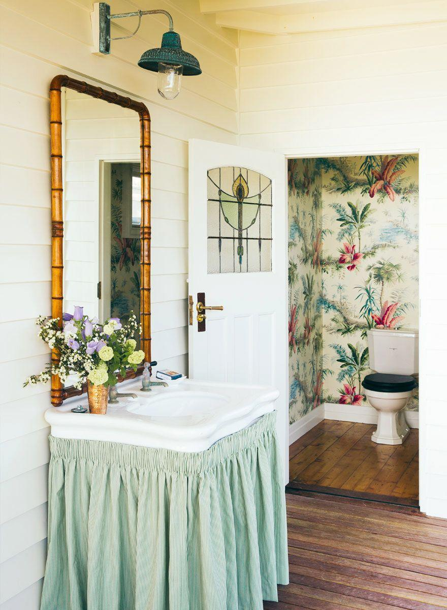 <p>Stained glass can work in a tropical setting, too: Here, Anna Spiro chose a wallpaper print that mimics the movement in the stained glass, which, by the way, is also perfect for a place where privacy is key (like a bathroom). </p>