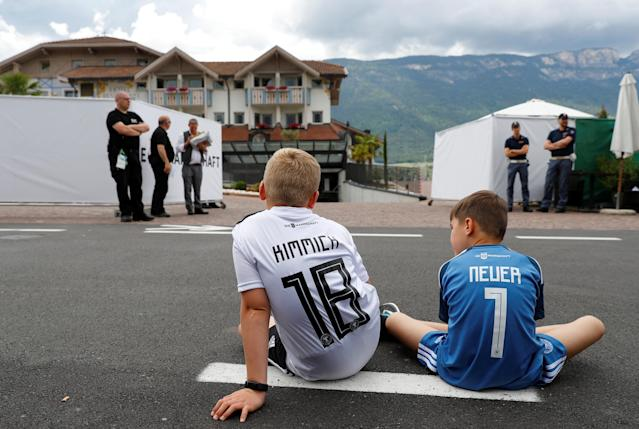 Soccer Football - FIFA World Cup - Germany Training - Eppan, Italy - May 23, 2018 Fans sit outside the German squad hotel in Eppan REUTERS/Leonhard Foeger